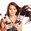 Stock Photo: Womholding iron curling hair.