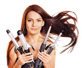 Woman holding iron curling hair. — Stok fotoğraf