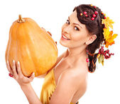 Woman holding autumn pumkin. — Stock Photo