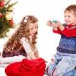 Kids with  gift box and sweet. - Stock Photo