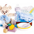 Baby diaper and toys with teddy bear . - Stock Photo