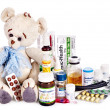 Child medicine and teddy bear. Isolated. — Stock Photo #13783765