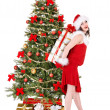 Christmas girl in santa hat holding red gift box. - Stock Photo
