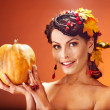 Woman holding autumn fruit. — Stock Photo