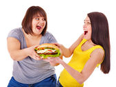 Women eating hamburger. — Foto Stock