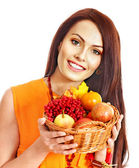 Woman holding autumn basket. — Foto de Stock