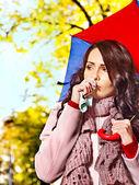 Woman sneezing handkerchief outdoor. — Stock Photo