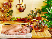 Woman getting massage in bamboo spa. — Foto Stock