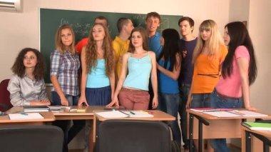 Student in classroom near blackboard. — Stock Video