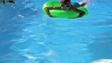 Child floating on inflatable ring in sea. — Stock Video