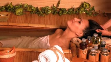 Woman getting massage in bamboo spa. — Stock Video