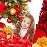 Child with gift box near Christmas tree. — Stock Photo #13971681