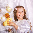 Kid with Christmas gift box. — Stock Photo #13971694