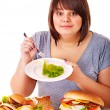 Woman choosing between fruit and hamburger. — Stock Photo #13972269