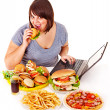 Woman eating junk food. — Stock Photo #13972321
