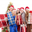 Group in santa hat holding stack gift box. — Stock Photo