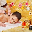Woman getting stone therapy massage . - Stock Photo