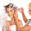 Woman wear hair curlers on head. — Stockfoto #13973848