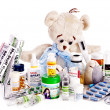 Child medicine and teddy bear. - Stock Photo