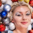 Young woman in christmas balls. — Stock Photo #13974197