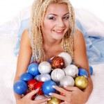 Woman in christmas balls. — Stock Photo
