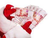 Santa Claus hand with Russian rouble money . — Stock Photo