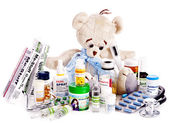 Child medicine and teddy bear. — Stockfoto