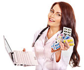 Doctor holding laptop and remedy. — Stock Photo