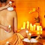 Woman getting thai herbal massage ball. — Stock Photo #14159789