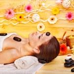 Woman getting stone therapy massage . — Stock Photo #14159805