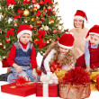 Stock Photo: Children with gift box near Christmas tree.