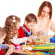 Stock Photo: Kindergarden teacher with group children.
