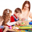 Kindergarden teacher with group children. — Stock Photo #14159898