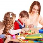 Kindergarden teacher with group children. — Stock Photo