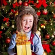 Kid with Christmas gift box. — Stock Photo #14159921