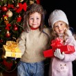 Kid with Christmas gift box. — Stock Photo #14159925