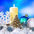 Christmas still life with snowflake and candle. — Stock Photo