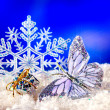 Christmas still life with snowflake and candle. — Stockfoto