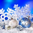 Christmas still life with snowflake and ball. — Stock Photo #14159942