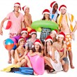 Royalty-Free Stock Photo: Group holding beach accessories.