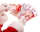 Santa Claus hand with money Russian rouble. — Stock Photo