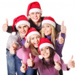 Royalty-Free Stock Photo: Group young in santa hat show thumbs up.