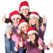 Group young in santa hat show thumbs up. — Stock Photo #14160005