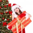 Stock Photo: Christmas girl in santa holding gift box.