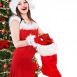 Girl in Santa hat holding christmas socks and gift box. — Stock Photo