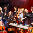 Band playing musical  instrument. - Foto Stock