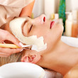 Clay facial mask in beauty spa. — Stock Photo #14160218