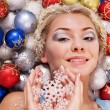Young woman in christmas balls. — Lizenzfreies Foto
