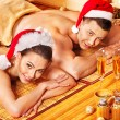 Man and woman relaxing in Xmas spa. - Stockfoto