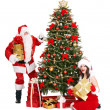 Girl and Santa clause by Christmas tree. — Stock Photo #14160574